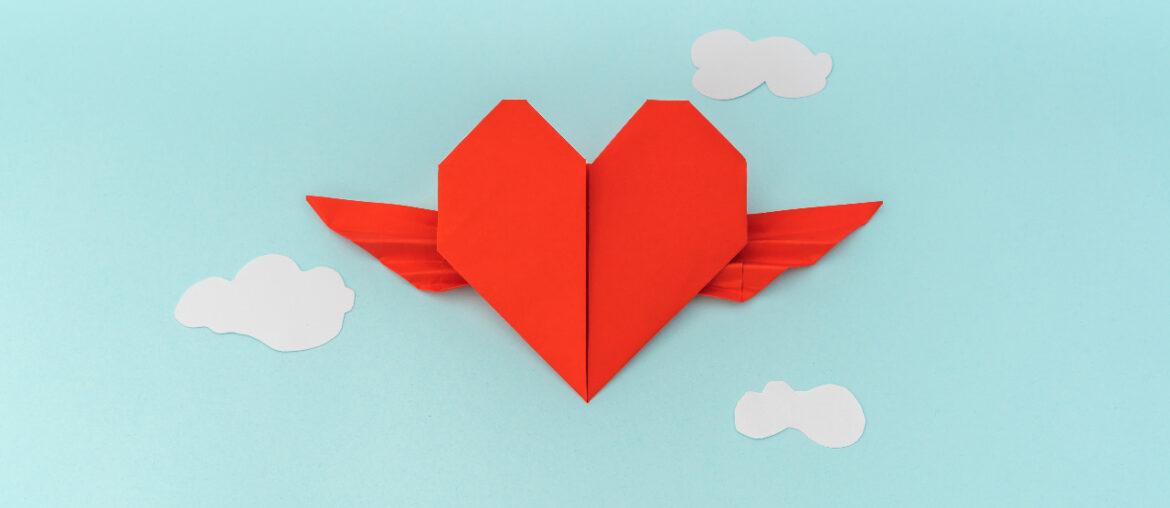 vector-heart-flying-in-clouds