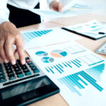 man-planning-business-account-with-analytics-report