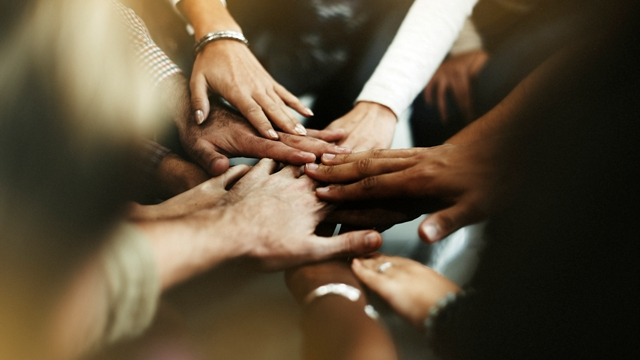 diverse-people-joining-their-hands