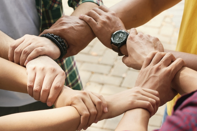 different-people-holding-hands-together